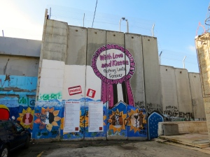The Separation Wall has graffiti on the Palestinian side, with messages of love and hope for change.